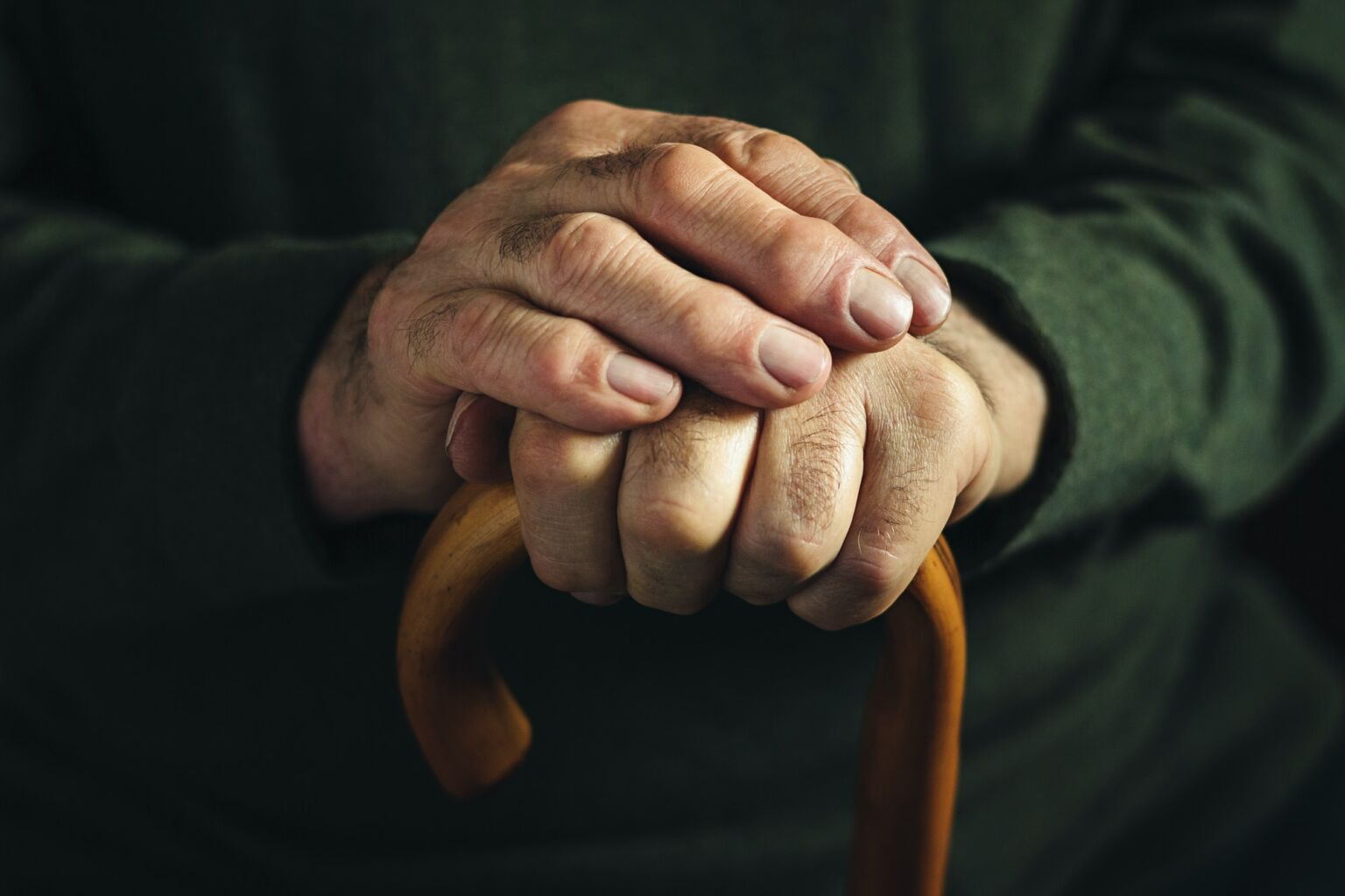 Gnarled arthritic fingers of an old man