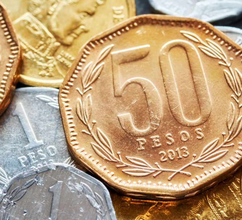 Extreme close up picture of Chilean peso coins.